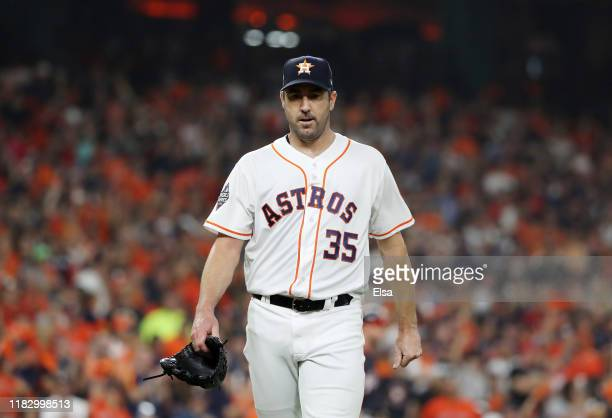 Justin Verlander of the Houston Astros walks off the field after retiring the side in the first inning against Washington Nationals in Game Two of...