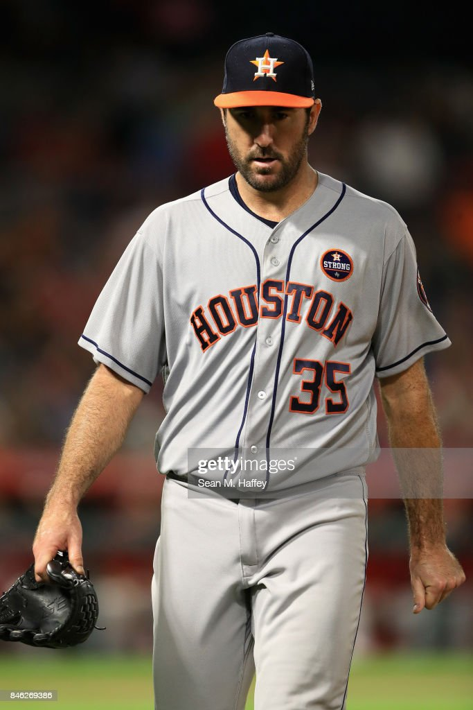 Justin Verlander #35 of the Houston Astros walks off the mound at the end of the eighth inning during a game against the Los Angeles Angels of Anaheim at Angel Stadium of Anaheim on September 12, 2017 in Anaheim, California.