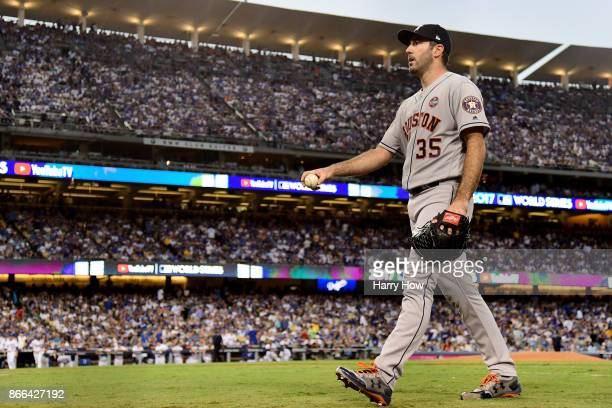 Justin Verlander of the Houston Astros walks to the dugout after pitching the third inning against the Los Angeles Dodgers in game two of the 2017...
