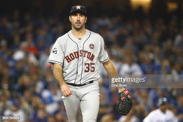 Justin Verlander of the Houston Astros walks to the dugout after pitching the fifth inning against the Los Angeles Dodgers in game six of the 2017...