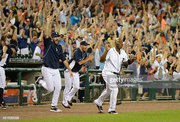 Justin Verlander Rick Porcello and Torii Hunter of the Detroit Tigers run onto the field and celebrate the walkoff grand slam home run hit by Rajai...