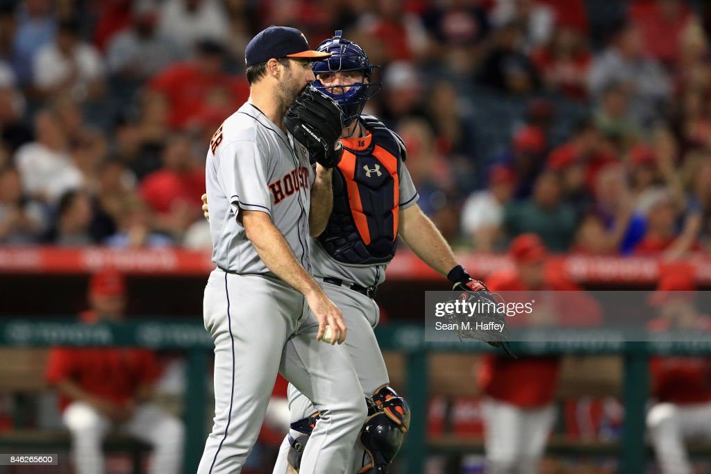 Justin Verlander #35 talks with Brian McCann #16 of the Houston Astros during the seventh inning of a game against the Los Angeles Angels of Anaheim at Angel Stadium of Anaheim on September 12, 2017 in Anaheim, California.