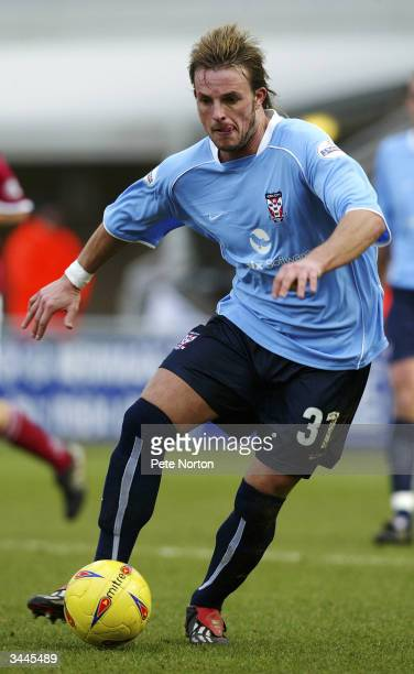 Justin Walker of York City runs with the ball during the Nationwide League Division Three match between Northampton Town and York City held on...