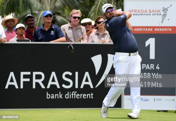 Justin Walters of South Africa tees off on the first hole during the final round of the AfrAsia Bank Mauritius Open at Heritage Golf Club on December...