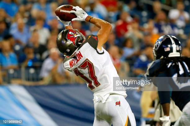 Justin Watson of the Bucs reaches up to make a catch the touchdown pass during the preseason game between the Tennessee Titans and Tampa Bay...