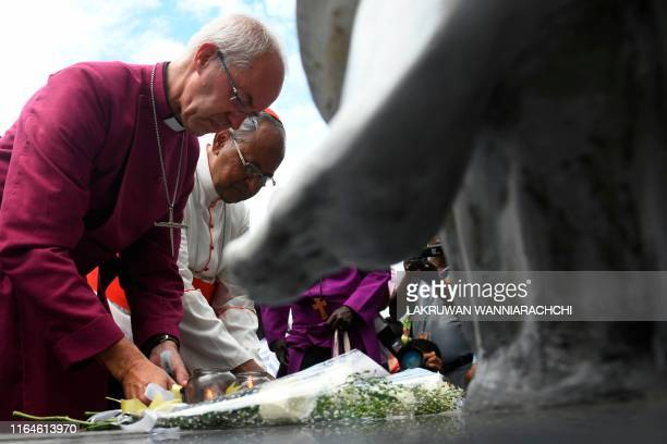 Justin Welby the Archbishop of Canterbury and Archbishop of Colombo Malcolm Ranjith lay flower as they pay homage to victims of the Easter Sunday...