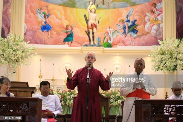 Justin Welby, the Archbishop of Canterbury speaks as the Archbishop of Colombo Cardinal Malcolm Ranjith listens at St. Sebastian's church in...