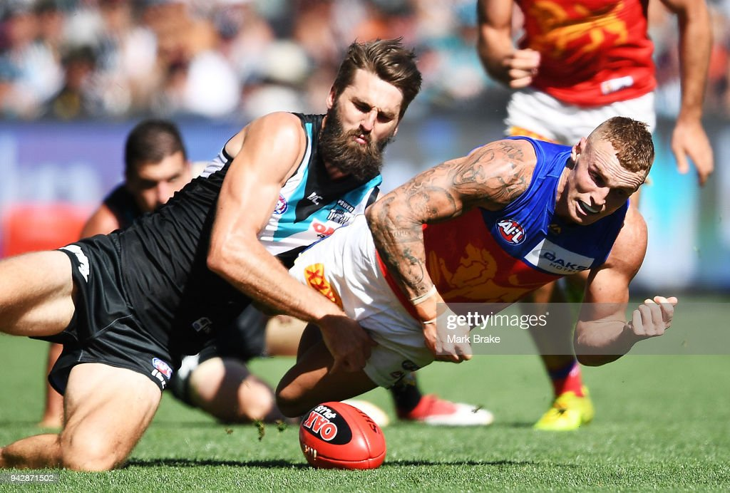 Justin Westhoff of Port Adelaide catches Mitch Robinson of the Lions during the round three AFL match between the Port Adelaide Power and the Brisbane Lions at Adelaide Oval on April 7, 2018 in Adelaide, Australia.