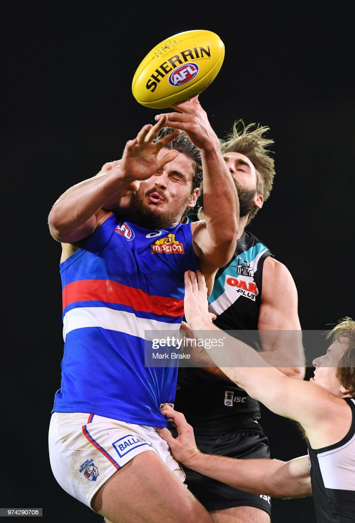 Justin Westhoff of Port Adelaide competes with Tom Boyd of the Bulldogs during the round 13 AFL match between Port Adelaide Power and the Western Bulldogs at Adelaide Oval on June 14, 2018 in Adelaide, Australia.