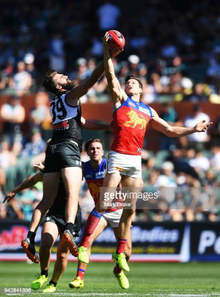 Justin Westhoff of Port Adelaide rucks against Stefan Martin of the Lions during the round three AFL match between the Port Adelaide Power and the...