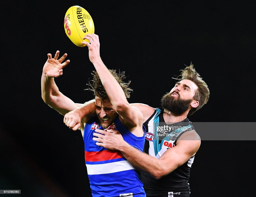 Justin Westhoff of Port Adelaide spoils Marcus Bontempelli of the Bulldogs during the round 13 AFL match between Port Adelaide Power and the Western Bulldogs at Adelaide Oval on June 14, 2018 in Adelaide, Australia.