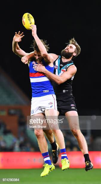 Justin Westhoff of Port Adelaide spoils Marcus Bontempelli of the Bulldogs during the round 13 AFL match between Port Adelaide Power and the Western...