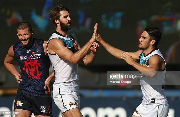 Justin Westhoff of the Power and Chad Wingard celebrate a goal during the round nine AFL match between the Melbourne Demons and the Port Adelaide...