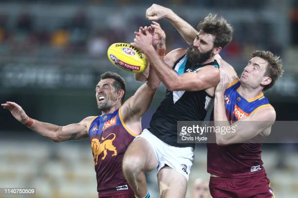 Justin Westhoff of the Power and Harris Andrews of the Lions compete for the ball kicks during the round three AFL match between the Brisbane Lions...