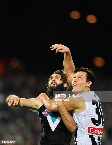 Justin Westhoff of the Power competes for the ball with Darcy Moore of the Magpies during the round 21 AFL match between Port Adelaide Power and the...