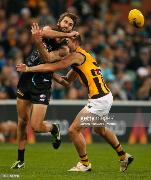 Justin Westhoff of the Power is tackled by Ricky Henderson of the Hawks during the 2017 AFL round 11 match between Port Adelaide Power and the...