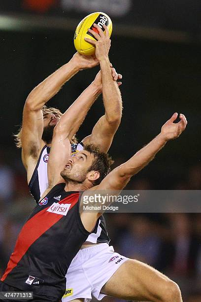 Justin Westhoff of the Power marks the ball against Jobe Watson of the Bombers during the round three AFL NAB Challenge match between the Essendon...