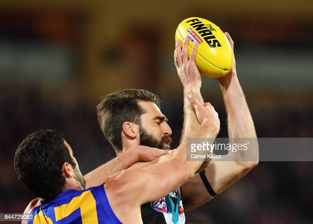 Justin Westhoff of the Power marks the ball over Jack Darling of the Eagles during the AFL First Elimination Final match between Port Adelaide Power...