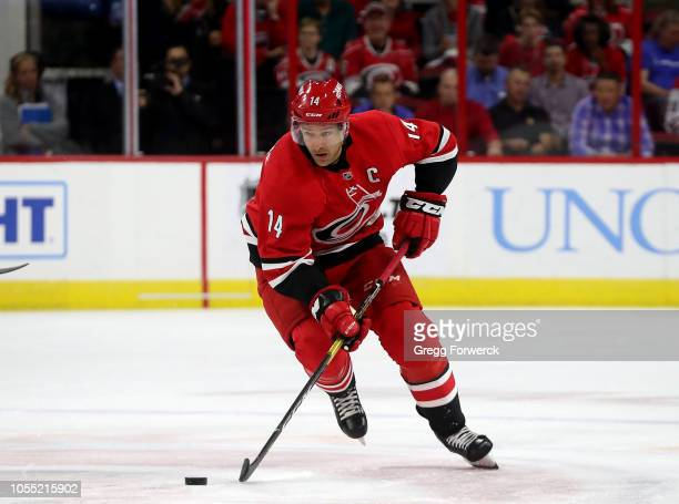 Justin Wiilliams of the Carolina Hurricanes skates with the puck during an NHL game against the Vancouver Canucks on October 9, 2018 at PNC Arena in...