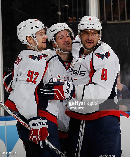 Justin Williams Alex Ovechkin and Evgeny Kuznetsov of the Washington Capitals celebrate after a second period goal against the New York Rangers at...