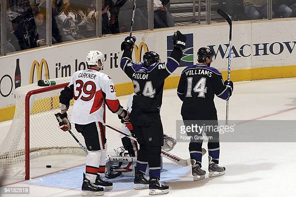 Justin Williams and Alexander Frolov of the Los Angeles Kings celebrate a goal against the Ottawa Senators during the game on December 3, 2009 at...