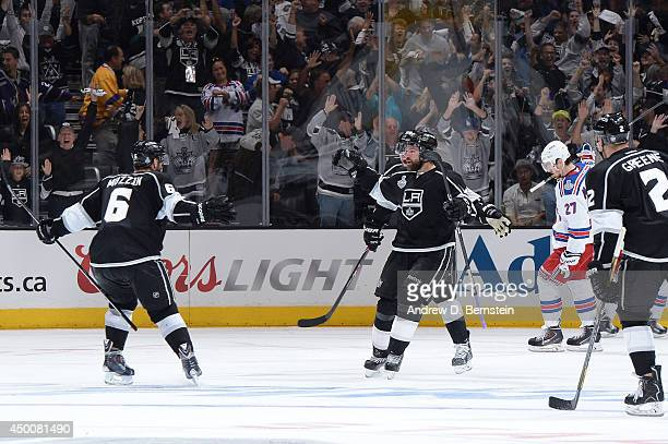 Justin Williams and Jake Muzzin of the Los Angeles Kings celebrate after defeating the New York Rangers in overtime of Game One of the Stanley Cup...