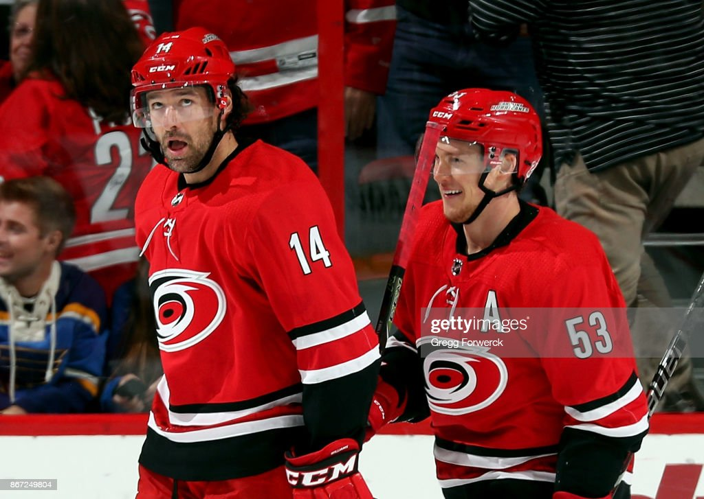 Justin Williams #14 and Jeff Skinner #53 of the Carolina Hurricanes react to Skinner's second-period goal against the St. Louis Blues during an NHL game on October 27, 2017 at PNC Arena in Raleigh, North Carolina.