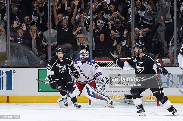 Justin Williams and Tanner Pearson of the Los Angeles Kings celebrate after defeating the New York Rangers in overtime of Game One of the Stanley Cup...