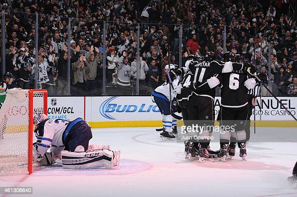 Justin Williams Anze Kopitar and Jake Muzzin of the Los Angeles Kings celebrate a goal during a game against the Winnipeg Jets at STAPLES Center on...