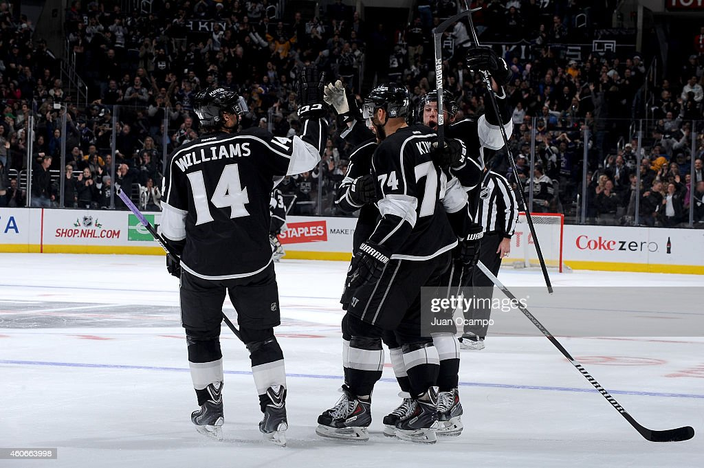 Justin Williams #14, Dwight King #74 and Jake Muzzin #6 of the Los Angeles Kings celebrate a goal during a game against the St. Louis Blues at STAPLES Center on December 18, 2014 in Los Angeles, California.