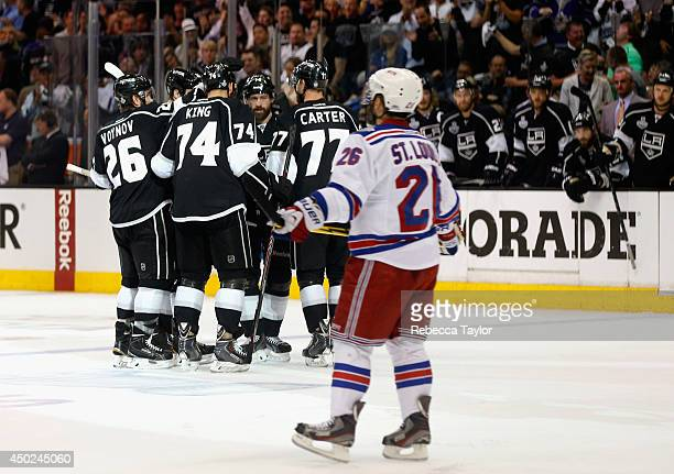 Justin Williams, Jeff Carter, Slava Voynov, Dwight King and Jarret Stoll of the Los Angeles Kings celebrate a goal scored by teammate Willie Mitchell...