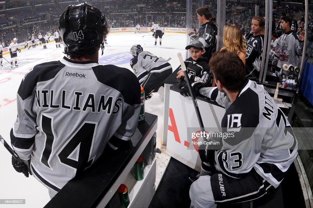 Justin Williams #14, Jonathan Quick #32 and Willie Mitchell #33 of the Los Angeles Kings warm up prior to the game against the Anaheim Ducks at Staples Center on April 12, 2014 in Los Angeles, California.