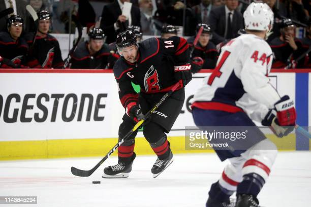 Justin Williams of the Carolina Hurricanes carries the puck in Game Four of the Eastern Conference First Round against the Washington Capitals during...