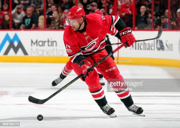 Justin Williams of the Carolina Hurricanes carries the puck into the neutral zone during an NHL game agains the Minnesota Wild on October 7 2017 at...