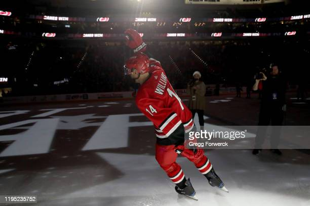Justin Williams of the Carolina Hurricanes celebrates after being named 1st star of the game after defeating the Winnipeg Jets during an NHL game on...