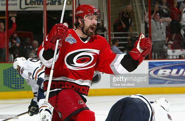 Justin Williams of the Carolina Hurricanes celebrates after Frantisek Kaberle scored a power play goal past goaltender Jussi Markkanen of the...