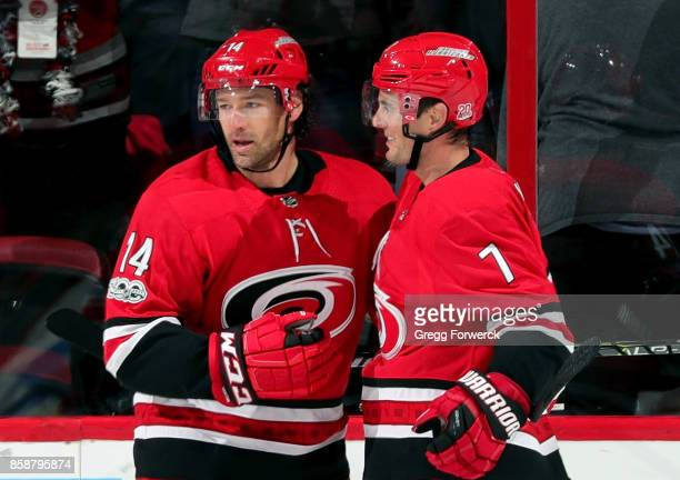 Justin Williams of the Carolina Hurricanes celebrates his secondperiod goal against of the Minnesota Wild with teammate Derek Ryan during an NHL game...