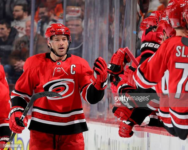 Justin Williams of the Carolina Hurricanes celebrates his goal with teammates on the bench in the second period against the Philadelphia Flyers at...