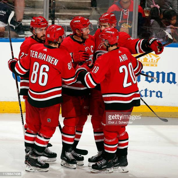 Justin Williams of the Carolina Hurricanes celebrates his third period goal with teammates for a 43 win over the Florida Panthers at the BBT Center...