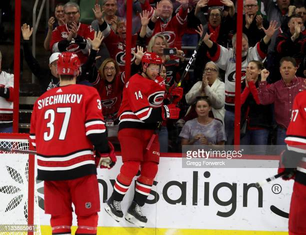 Justin Williams of the Carolina Hurricanes celebrates with fans during a Storm Surge during an NHL game against the Philadelphia Flyers on March 30...