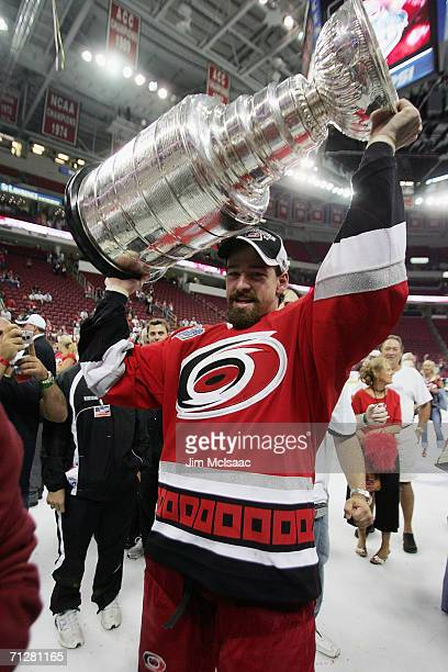 Justin Williams of the Carolina Hurricanes celebrates with the Stanley Cup after defeating the Edmonton Oilers during game seven of the 2006 NHL...