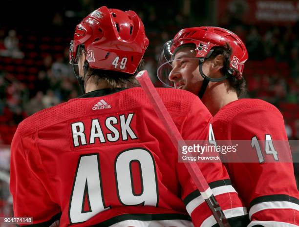 Justin Williams of the Carolina Hurricanes congraulates teammate Victor Rask who scores a goal during an NHL game against the Washington Capitals on...