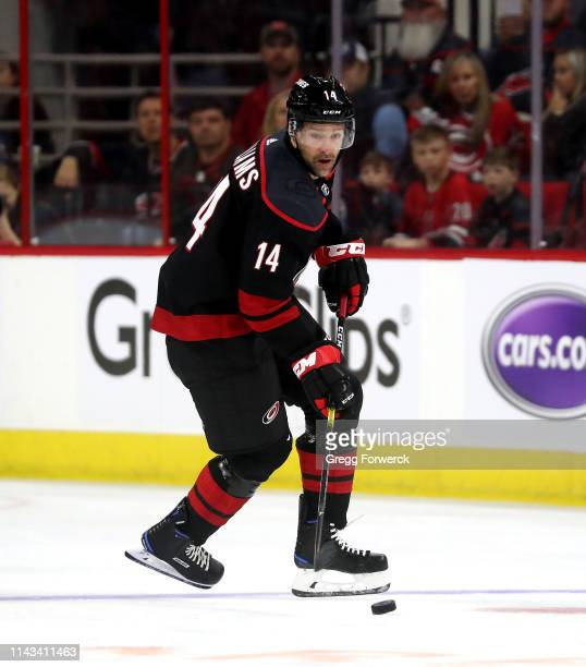 Justin Williams of the Carolina Hurricanes controls the puch in Game Three of the Eastern Conference First Round against the Washington Capitals...