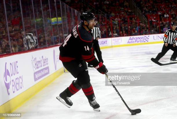Justin Williams of the Carolina Hurricanes controls the puck on the ice during an NHL game against the Anaheim Ducks on November 30 2018 at PNC Arena...