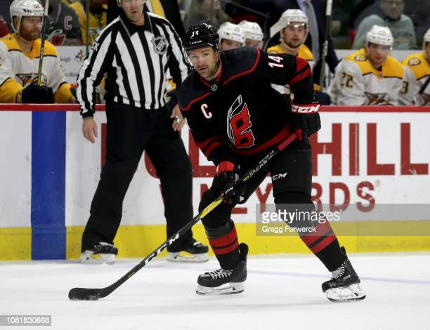 Justin Williams of the Carolina Hurricanes controls the puck on the ice during an NHL game against the Nashville Predators on January 13 ,2019 at PNC...