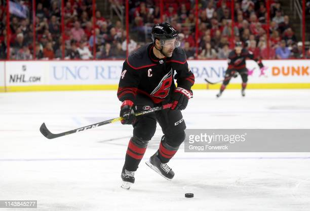 Justin Williams of the Carolina Hurricanes controls the puck on the ice in Game Four of the Eastern Conference First Round against the Washington...