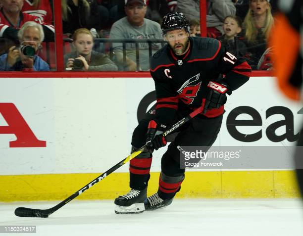 Justin Williams of the Carolina Hurricanes controls the puck on the ice in Game Three of the Eastern Conference Third Round against the Boston Bruins...