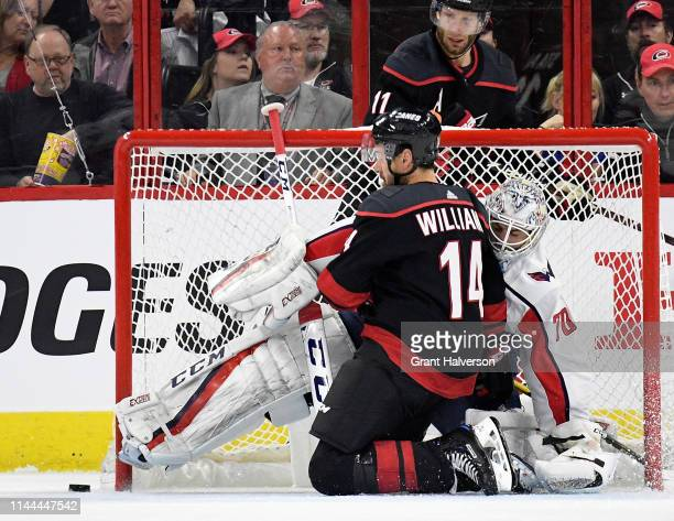 Justin Williams of the Carolina Hurricanes crashes into Braden Holtby of the Washington Capitals in the second period of Game Six of the Eastern...