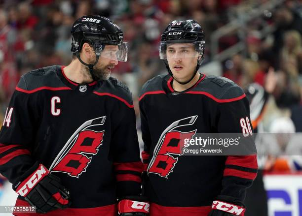 Justin Williams of the Carolina Hurricanes discusses strategy prior to a faceoff with Teuvo Teravainen in Game Four of the Eastern Conference Second...
