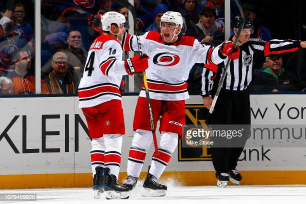 Justin Williams of the Carolina Hurricanes is congratulated by his teammate Micheal Ferland after scoring a third period goal against the New York...